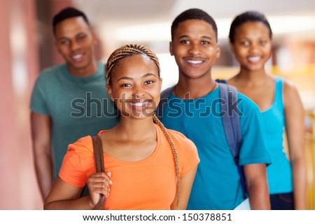 beautiful african college girl with friends on campus - stock photo