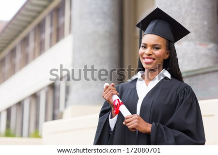 beautiful african female student with graduation certificate - stock photo