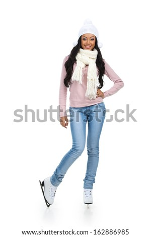 Beautiful African girl posing at skating ring. Full length isolated on white  - stock photo