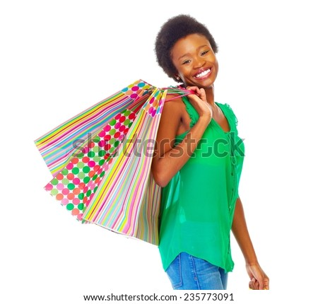 Beautiful african girl with shopping bags isolated white background - stock photo