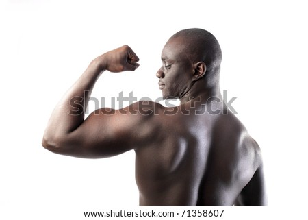 Beautiful african man showing his muscles - stock photo