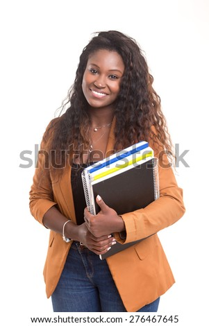 Beautiful african student woman posing isolated over white background