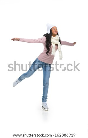 Beautiful African woman doing figure skating. Isolated on white background  - stock photo