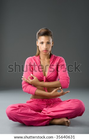 Beautiful african woman doing some meditation - stock photo