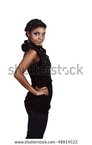 Beautiful African woman in jeans and top ready for a party - stock photo