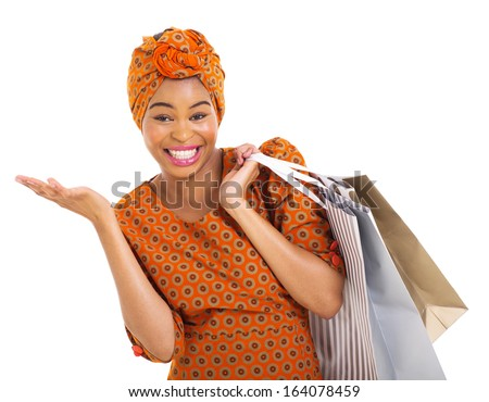 beautiful african woman in traditional clothes carrying shopping bags on white background - stock photo