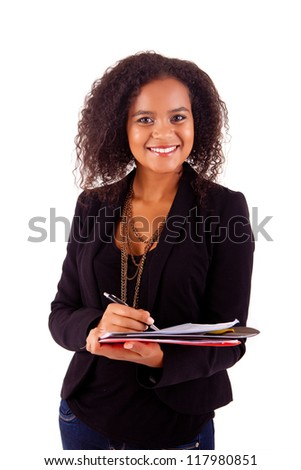 Beautiful african woman scheduling an appointment - stock photo