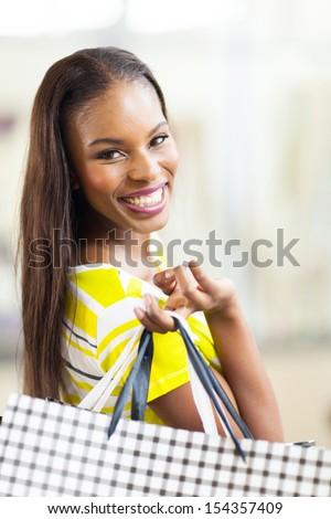 beautiful african woman shopping spree in mall - stock photo
