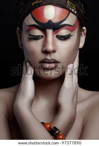 beautiful African woman with artistic make-up - stock photo