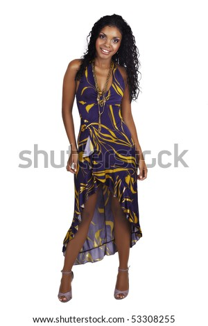 Beautiful African woman with long curly hair in purple halter neck dress and purple make-up - stock photo