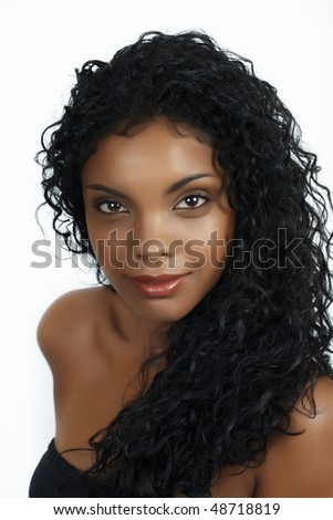 Beautiful African woman with long natural curly hair and natural make-up - stock photo