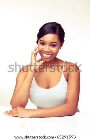 Beautiful African woman with natural make-up laughing on white background. - stock photo