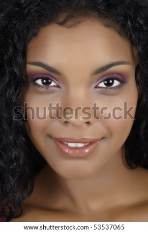 Beautiful African woman with pink eyeshadow and natural make-up. - stock photo