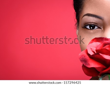 Beautiful African Woman with Rose   - stock photo