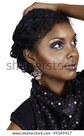 Beautiful African woman with with smoky eyeshadows in party sequin dress - stock photo