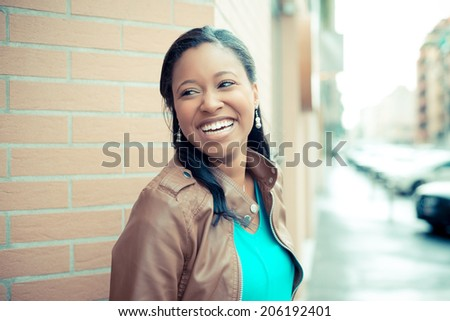 beautiful african young woman in the city - stock photo
