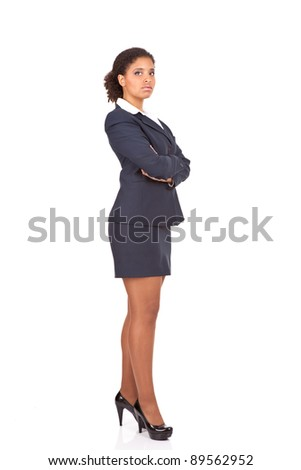 beautiful afro businesswoman posing with her arms crossed,  isolated over white background - stock photo
