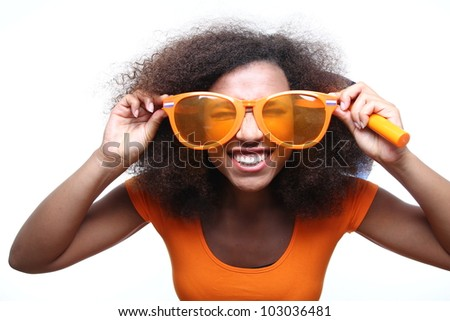 Beautiful afro woman holding a scale - stock photo