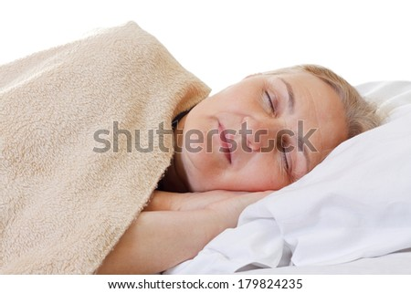 Beautiful aged woman sleeping in her bed - stock photo