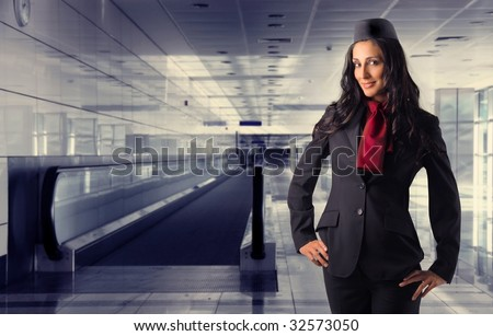 beautiful air Hostess in an airport - stock photo