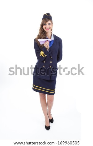Beautiful air hostess with a paper airplane isolated on white background - stock photo