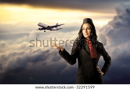 beautiful air hostess with flying airplane - stock photo