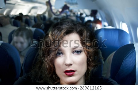 Beautiful air passenger. - stock photo