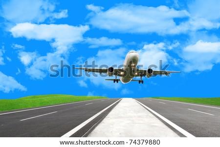 beautiful airplane landing on runway in summer - stock photo