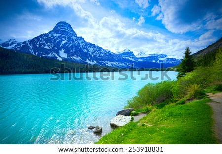 Beautiful Alberta Mountains and Blue Cloudy Sky, Canada Vacation Landscape