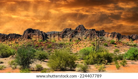 Beautiful all natural Image of Cloud formations and rocky Mountains near the Border of New Mexico and mexico - stock photo