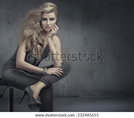 Beautiful alluring young woman - stock photo