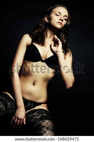 Beautiful alluring young woman in sexy lingerie  - stock photo