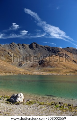 Beautiful alpine lake with green water under a clear blue sky