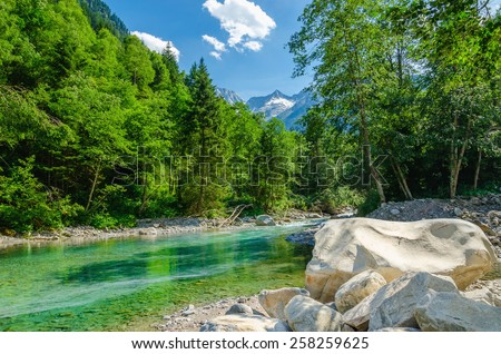 Beautiful alpine landscape with a mountain brook on the background of the high peaks of the mountains, the Alps, Austria - stock photo