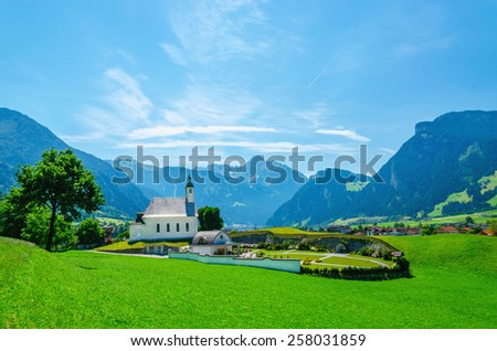 Beautiful alpine landscape with typical white high alpine church, Austrian Alps, Europe - stock photo