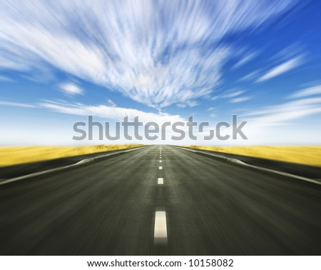 Beautiful altitude horizon with blue cloudy sky and vivid yellow high grass. - stock photo