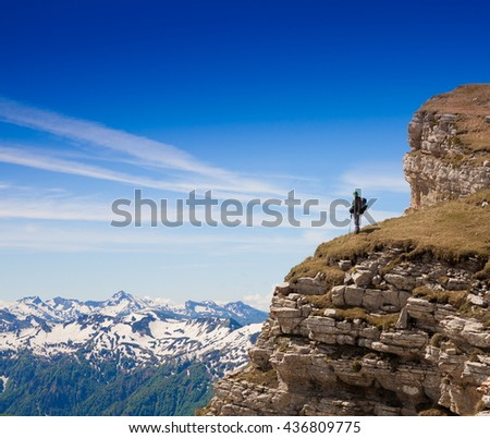 Beautiful amazing day summer mountains. A man goes a sport hike in holidays. Nature background. Northern country Russia Caucasus wilderness. Rocky route. Blue sky. Inspiring leisure.