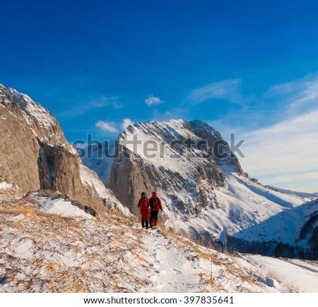 Beautiful amazing day winter mountains. A man goes a sport hike in snow holidays. Nature background. Northern country Russia Caucasus. Go to the aim.  - stock photo