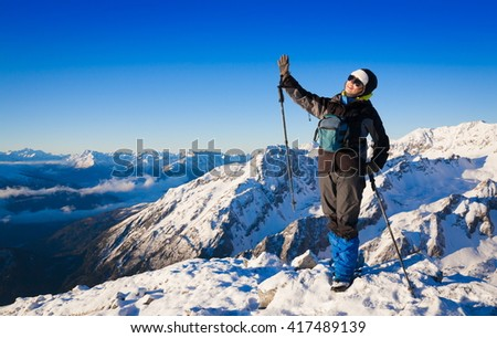Beautiful amazing day winter mountains. A woman goes a sport hike in snow holidays. Nature background. Northern country Russia Caucasus. Go to the aim.  - stock photo