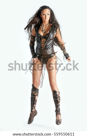 beautiful amazon with dagger in leather clothing