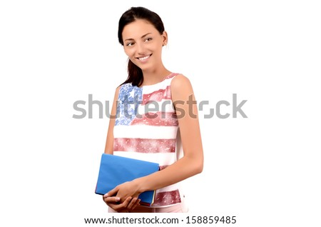 Beautiful American student with USA flag on her blouse holding books and looking away. Learn English. Isolated on white. - stock photo