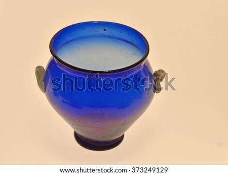 Beautiful ancient roman vase in blue glass with two small handles - stock photo