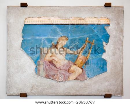 Beautiful ancient roman wall-painting of Apollo Citharoedus (Apollo with lyre), Rome. - stock photo