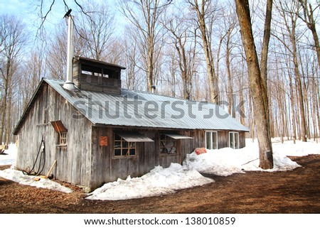 beautiful and aged sugar shack during spring season in Quebec, Canada - stock photo