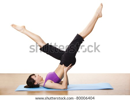 Beautiful and athletic young woman doing fitness exercises - stock photo