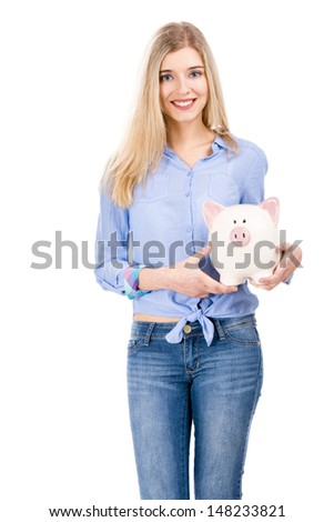Beautiful and attractive blonde woman holding a piggy bank, isolated over white background
