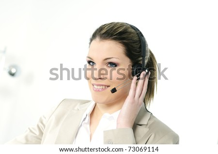 beautiful and cheerful blond girl with headphones - stock photo
