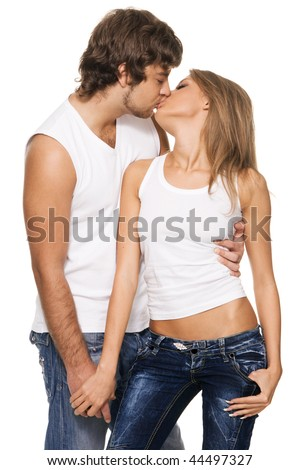 Beautiful and cheerful young couple in light casual clothing - stock photo