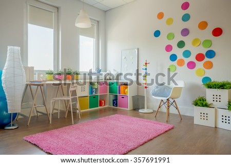 Beautiful and colorful bedroom for a girl  - stock photo