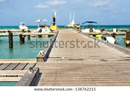 beautiful and colorful dock in Aruba - stock photo